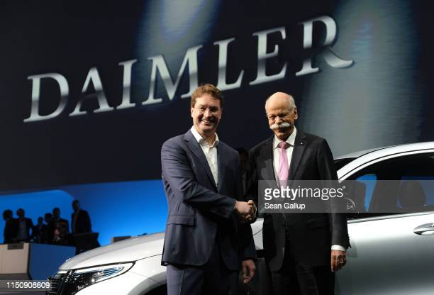 Dieter Zetsche Chairman of Daimler AG and Ola Källenius who will succeed Zetsche pose for photographers at the annual Daimler AG shareholders meeting...