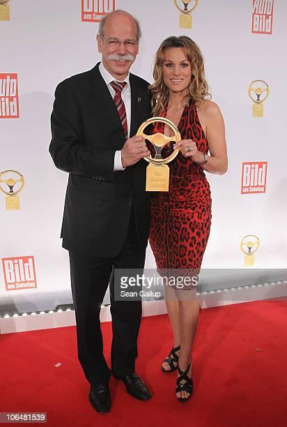 Dieter Zetsche Chairman of Daimler AG and race care driver Christina Surer attend the 2010 Das Goldene Lenkrad awards at Axel Springer Haus on...