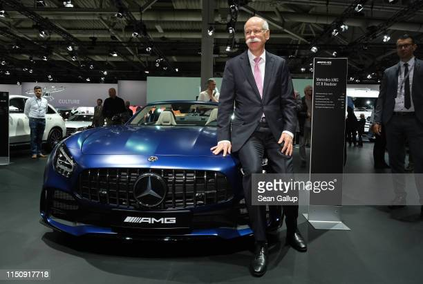Dieter Zetsche Chairman of Daimler AG poses for photographers on a MercedesBenz roadster at the annual Daimler AG shareholders meeting on May 22 2019...