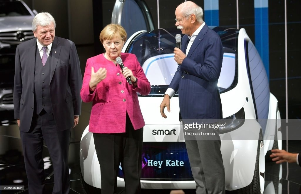 Dieter Zetsche (R), Chairman of Daimler AG, shows and Hesse Governor Volker Bouffier (L) and the German Chancellor Angela Merkel and the Primeminister of Hesse a Smart Vision EQ concept car during her visit at the 2017 Frankfurt Auto Show 'Internationale Automobil Ausstellung' (IAA) on September 14, 2017 in Frankfurt am Main, Germany. The Frankfurt Auto Show is taking place during a turbulent period for the auto industry. Leading companies have been rocked by the self-inflicted diesel emissions scandal. At the same time the industry is on the verge of a new era as automakers commit themselves more and more to a future that will one day be dominated by electric cars.