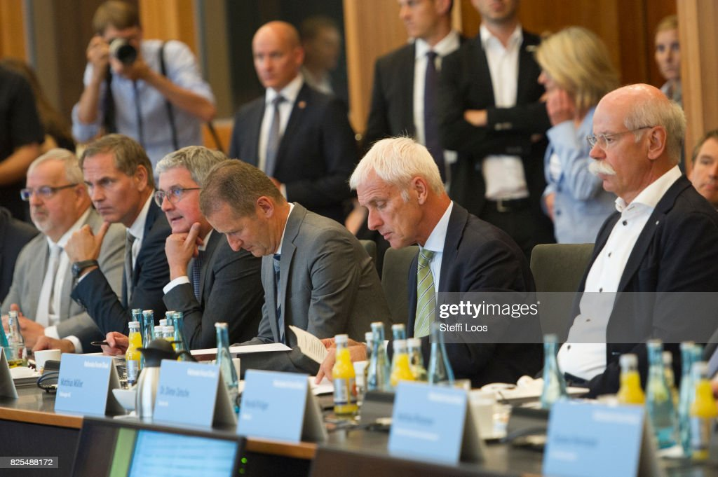Dieter Zetsche, chairman of German car maker Daimler AG (R-L), Matthias Mueller, Chairman of Volkswagen AG (L), Herbert Diess, chairman of the board Volkswagen brand and Rupert Stadler (L-R), Audi AG CEO (R) during Diesel Conference on August 2, 2017 in Berlin, Germany. Germany's car industry faces existential crisis after the emissions scandal and a cartels investigation.