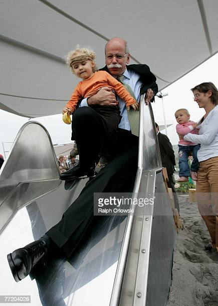 Dieter Zetsche Chairman of German car maker Daimler AG slides down a shoot with a child during the opening of a child day care center of Daimler AG...
