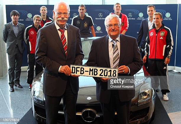 Dieter Zetsche, chairman of the board of Mercedes-Benz and Theo Zwanziger, president of the German Football Association pose in front of a...