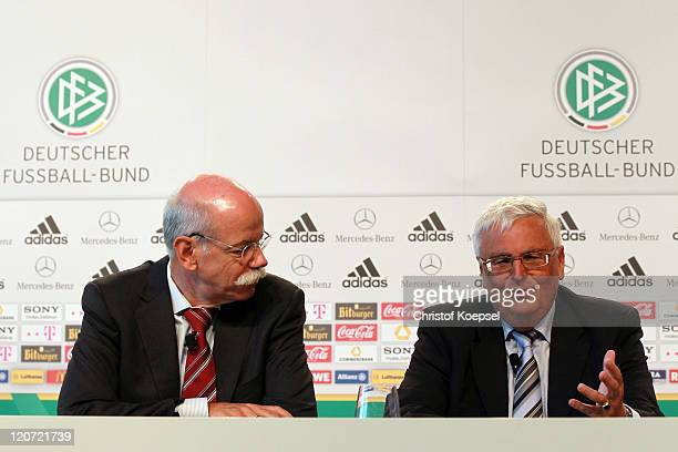 Dieter Zetsche, chairman of the board of Mercedes-Benz shake hands and Theo Zwanziger, president of the German Football Association attend a press...