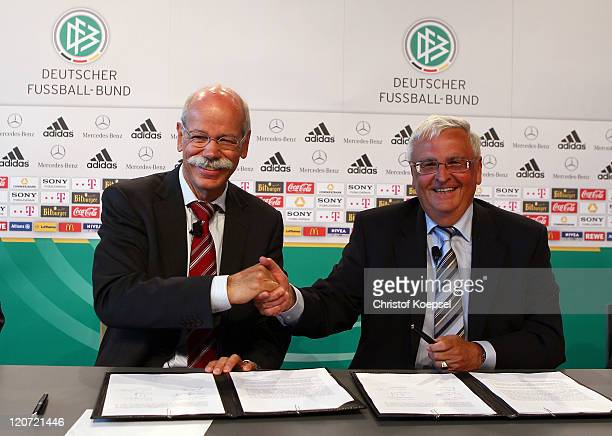Dieter Zetsche chairman of the board of MercedesBenz shake hands with Theo Zwanziger president of the German Football Association during a press...
