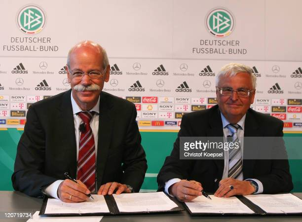 Dieter Zetsche chairman of the board of MercedesBenz signs a treaty with Theo Zwanziger president of the German Football Association during a press...