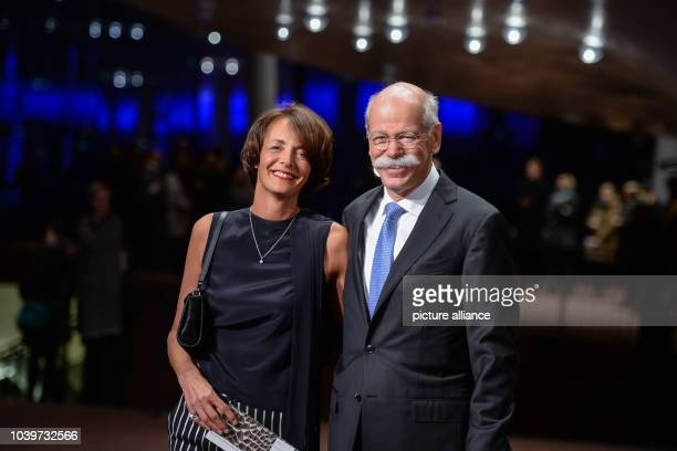 Dieter Zetsche chairman of the Daimler AG and his wife Anne arrive for the inauguration of the Elbphilharmonie in Hamburg Germany 11 January 2017 The...