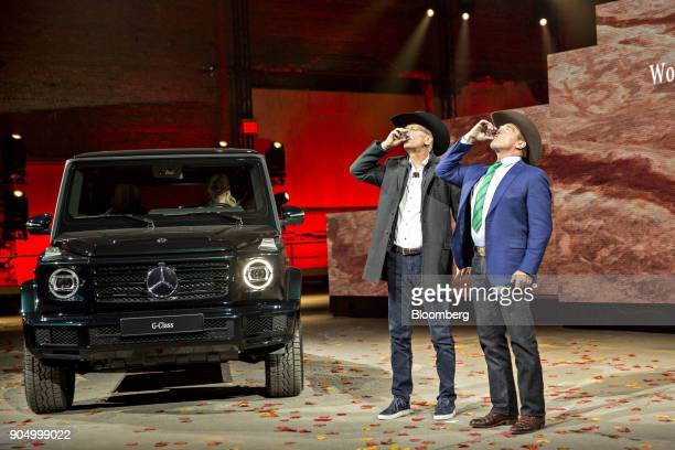 Dieter Zetsche chief executive officer of Daimler AG and Arnold Schwarzenegger former governor of California right drink a shot in celebration of the...