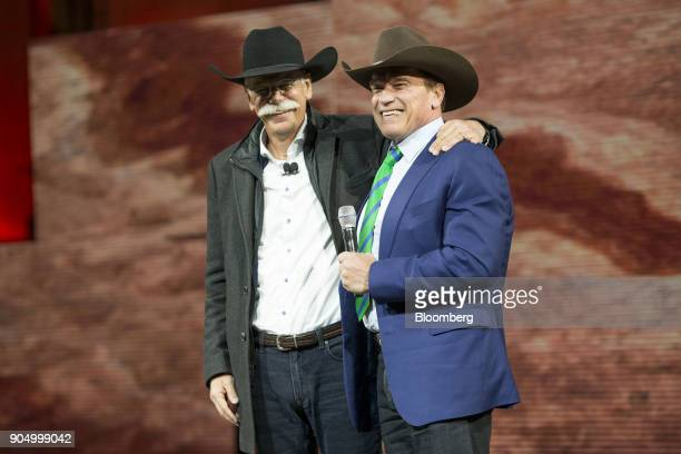 Dieter Zetsche chief executive officer of Daimler AG and Arnold Schwarzenegger former governor of California right speak during an event at the 2018...