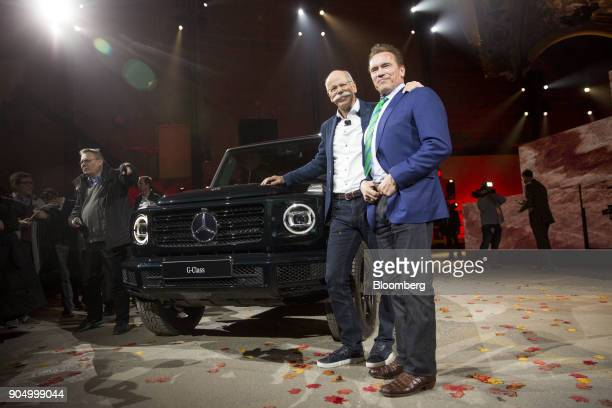 Dieter Zetsche chief executive officer of Daimler AG and Arnold Schwarzenegger former governor of California right stand for a photograph with the...