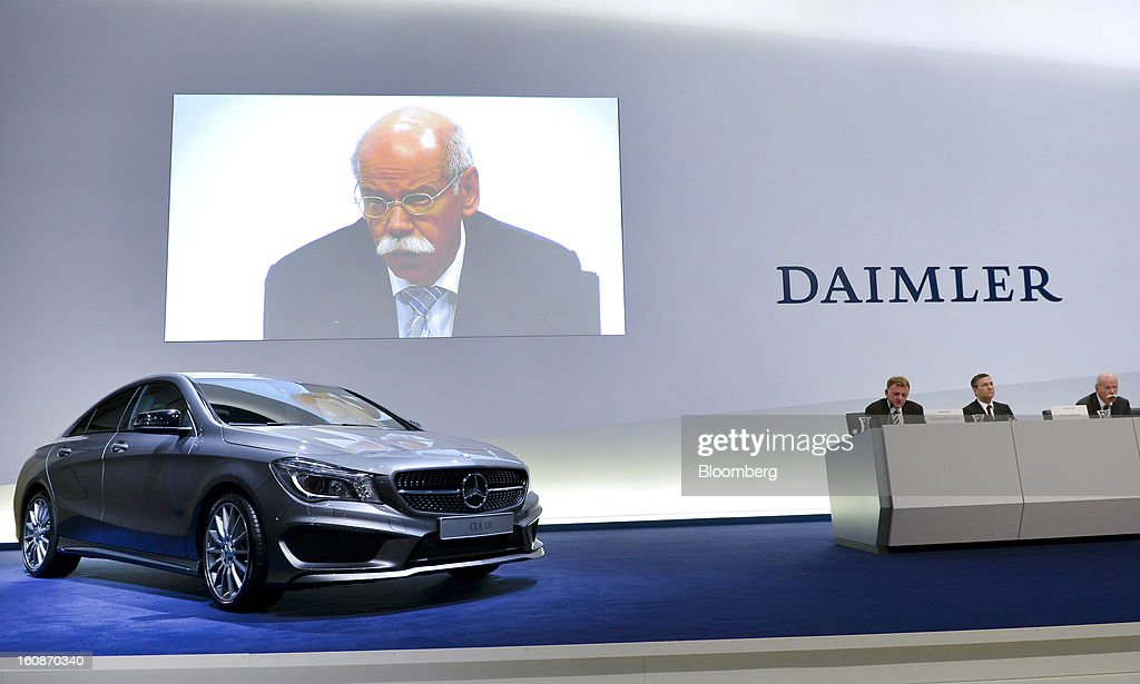 Dieter Zetsche, chief executive officer of Daimler AG, is seen on a large video screen above a Mercedes-Benz CLA 180 automobile as he speaks during a news conference to announce the company's results in Stuttgart, Germany, on Thursday, Feb. 7, 2013. Daimler AG, the world's third-largest maker of luxury vehicles, forecast unchanged 2013 profit as spending for new models and a revamp of the automaker's operations eat into earnings. Photographer: Guenter Schiffmann/Bloomberg via Getty Images