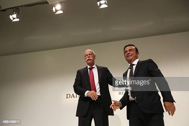 Dieter Zetsche chief executive officer of Daimler AG left and Carlos Ghosn chief executive officer of Renault SA and Nissan Motor Co stand following...