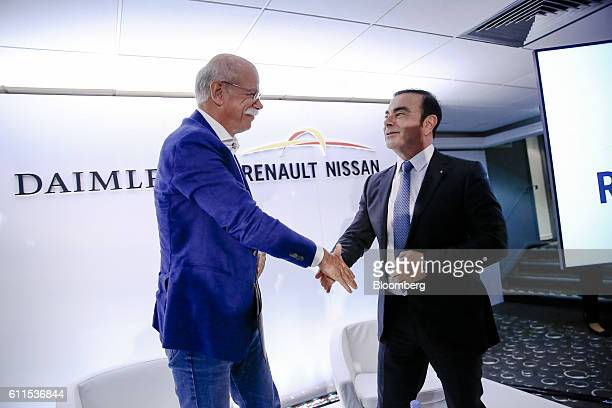Dieter Zetsche, chief executive officer of Daimler AG, left, shakes hands with Carlos Ghosn, chief executive officer of Renault SA and Nissan Motor...