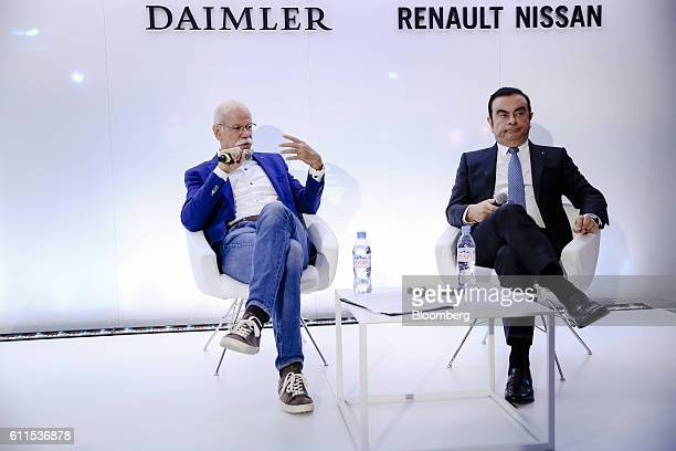 Dieter Zetsche, chief executive officer of Daimler AG, left, speaks as he sits beside Carlos Ghosn, chief executive officer of Renault SA and Nissan...