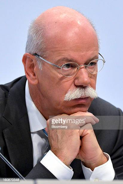 Dieter Zetsche chief executive officer of Daimler AG pauses during a news conference to announce the company's results in Stuttgart Germany on...
