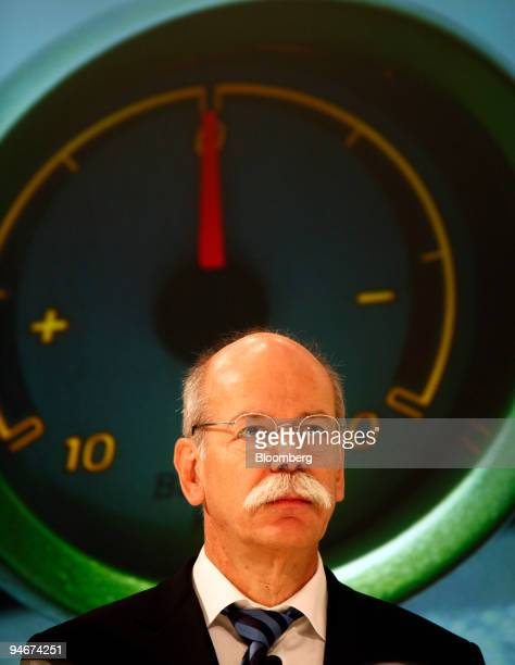 Dieter Zetsche chief executive officer of Daimler AG pauses in front of an image of a Smart electric drive automobile's battery indicator at a news...