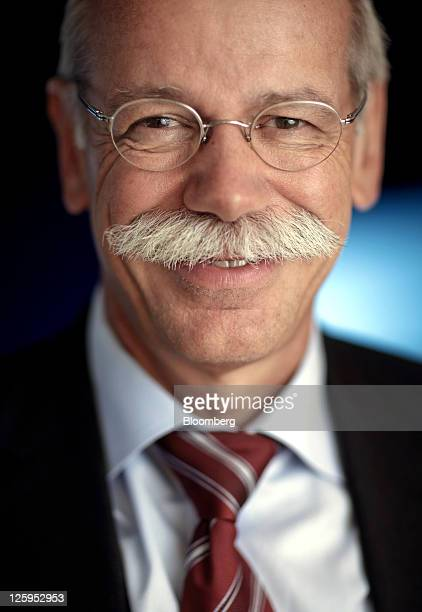 Dieter Zetsche chief executive officer of Daimler AG poses for a photograph following an interview at the Daimler Mercedes Benz AG stand during the...