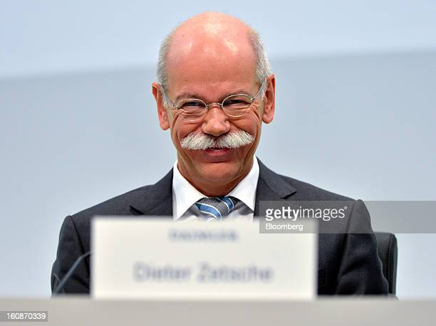 Dieter Zetsche chief executive officer of Daimler AG reacts during a news conference to announce the company's results in Stuttgart Germany on...