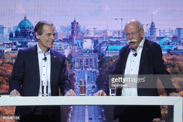 Dieter Zetsche chief executive officer of Daimler AG right speaks as Volkmar Denner chief executive officer of Robert Bosch GmbH reacts during the...