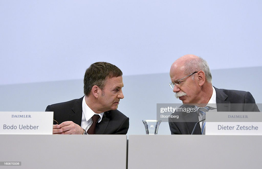 Dieter Zetsche, chief executive officer of Daimler AG, right, speaks with Bodo Uebber, chief financial officer of Daimler AG, during a news conference to announce the company's results in Stuttgart, Germany, on Thursday, Feb. 7, 2013. Daimler AG, the world's third-largest maker of luxury vehicles, forecast unchanged 2013 profit as spending for new models and a revamp of the automaker's operations eat into earnings. Photographer: Guenter Schiffmann/Bloomberg via Getty Images