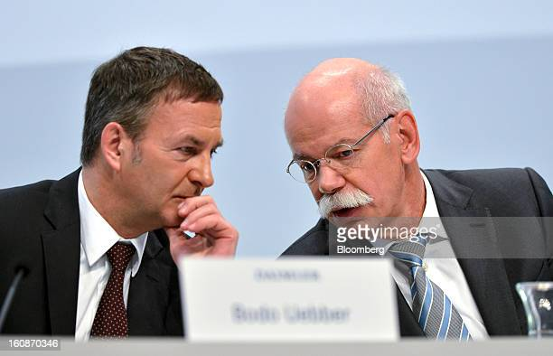 Dieter Zetsche chief executive officer of Daimler AG right speaks with Bodo Uebber chief financial officer of Daimler AG during a news conference to...
