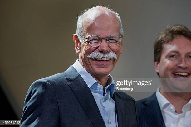 Dieter Zetsche chief executive officer of Daimler AG smiles as the new Mercedes GT automobile produced by MercedesAMG the performance unit of...