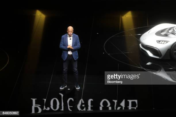 Dieter Zetsche chief executive officer of Daimler AG speaks beside a MercedesBenz AMG Project One hypercar during the first media preview day of the...