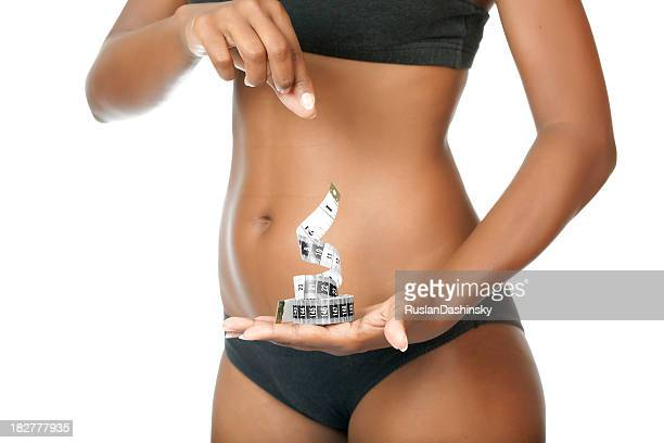 dieting and measuring. - skinny black woman stock photos and pictures