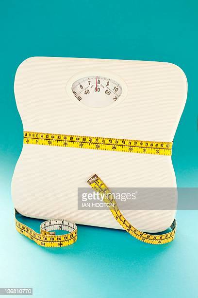 dieting, conceptual image - measuring tape stock photos and pictures