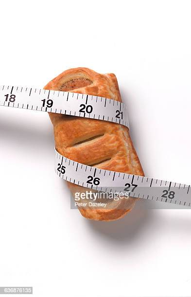 Dieting sausage roll and tape measure