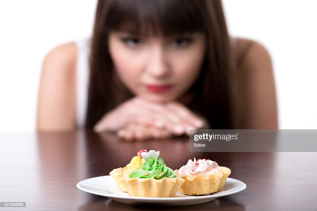 Dieting woman craving for cake : Stock Photo