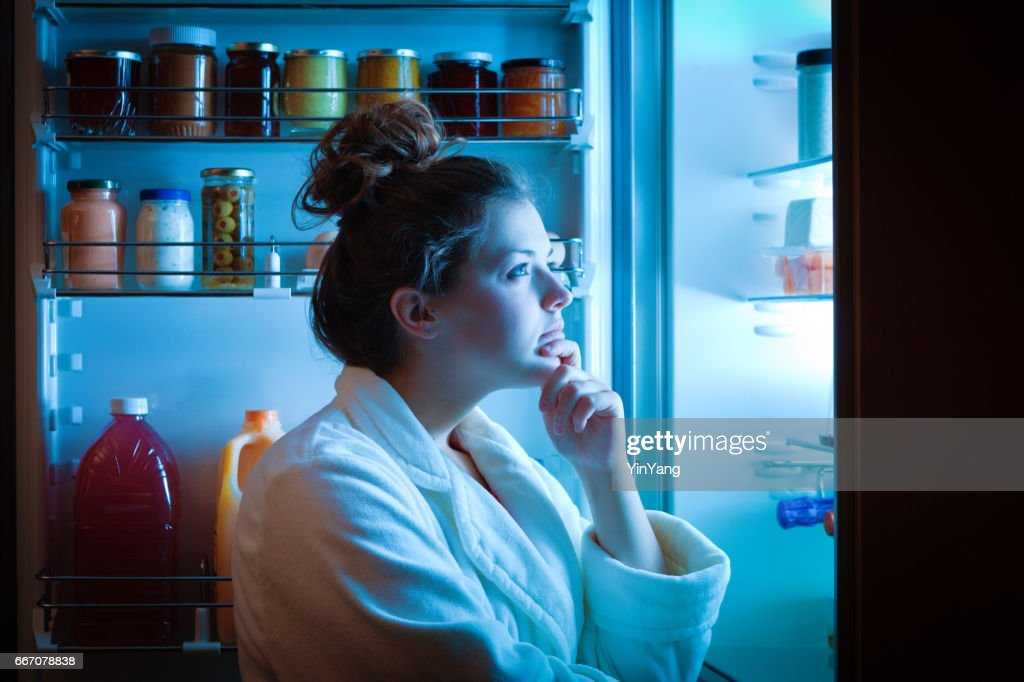 Dieting Young Woman Late Night Making Choices on What to Eat : Stock Photo