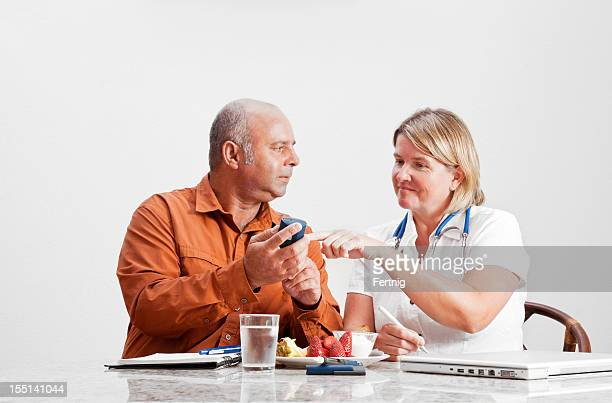 Dietitian, doctor or nurse consulting with a diabetic man.