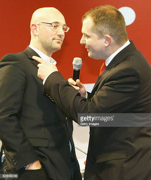 Dietmar Axt Country Manager Germany for Diesel talks to the Joerg Tadaeus before the award for best art direction at the LEAD Awards 2005 at the...