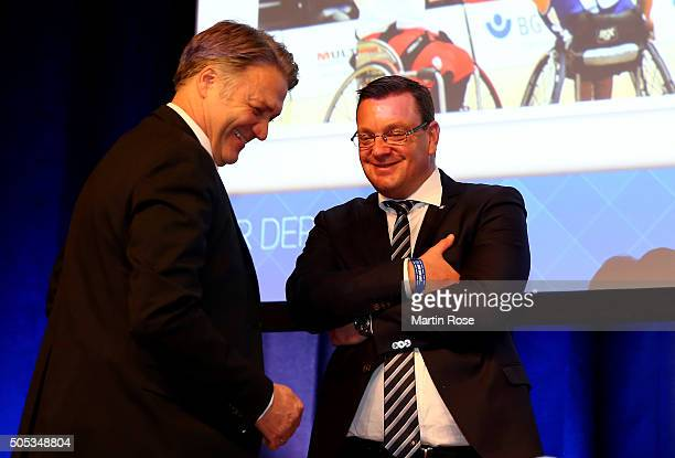 Dietmar Beiersdorfer , CEO of Hamburger Sport Verein AG talks to Henning Kinkhrost during the Hamburger SV General Assembly at Congress Center...