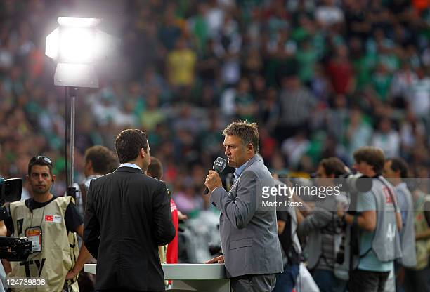 Dietmar Beiersdorfer gives an interview before the Bundesliga match between Werder Bremen and Hamburger SV at Weser Stadium on September 10, 2011 in...