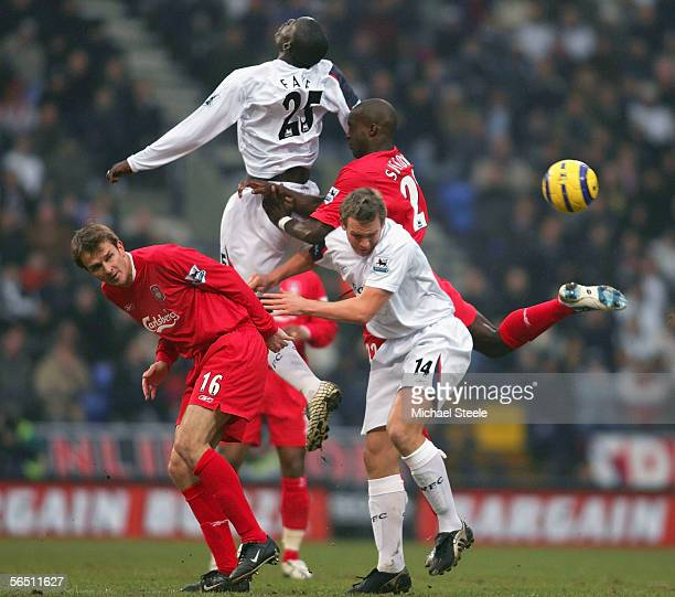 Dietmar Hamann and Momo Sissoko of Liverpool challenge Abdoulaye Faye and Kevin Davies of Bolton during the Barclays Premiership match between Bolton...
