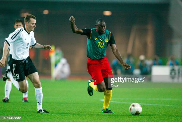 Dietmar HAMANN of Germany and Patrick MBOMA of Cameroon during the FIFA World Cup match between Cameroon and Germany on June 11 2002 in Ecopa de...