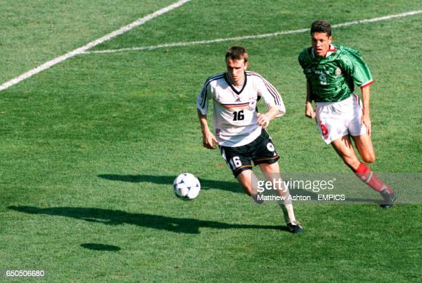 Dietmar Hamann of Germany tris to get away from Mexico's Ricardo Pelaez