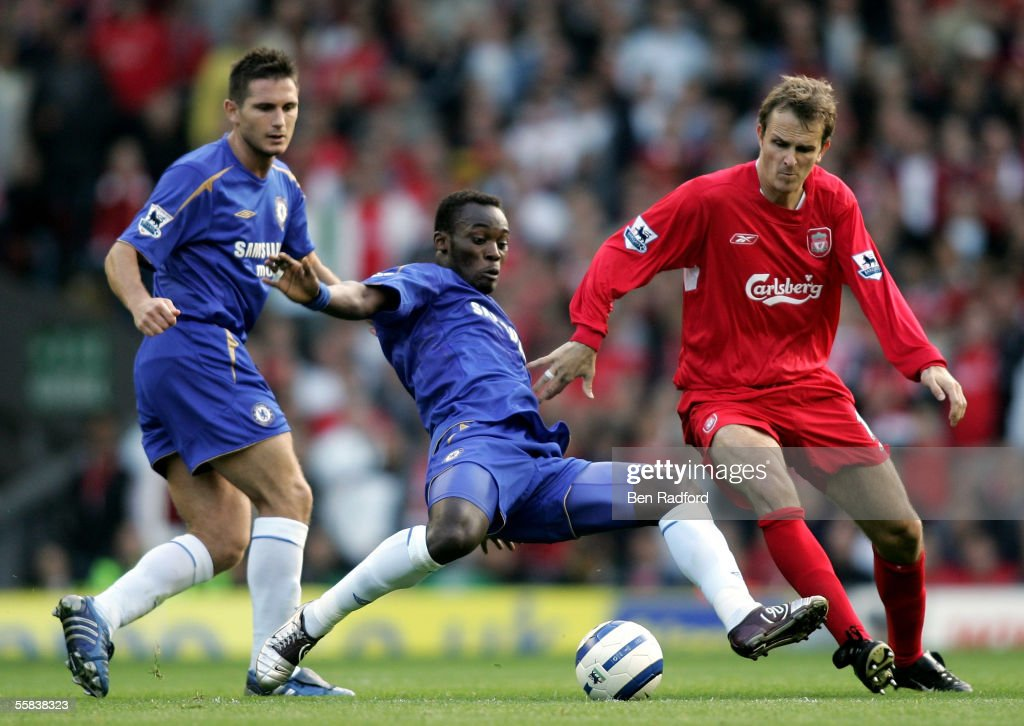 Dietmar Hamann of Liverpool and Michael Essien of Chelsea battle for the ball during the Barclays Premiership match between Liverpool and Chelsea at Anfield on October 2, 2005 in Liverpool, England.