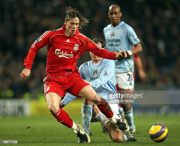 Dietmar Hamann of Manchester City vies with Fernando Torres of Liverpool during the Premier league football match at The City of Manchester Stadium...