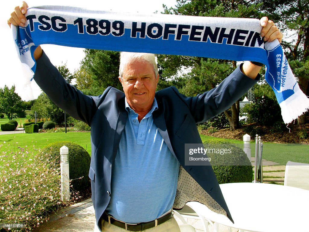 Dietmar Hopp, German billionaire and co-founder of SAP SE, poses for a photograph holding a supporters scarf for the German soccer club TSG 1988 Hoffenheim following a Bloomberg Television interview in Germany, on Monday, Aug. 25, 2015. Hopp is one of five founders of SAP, the world's largest maker of business-management software. Photographer: Stephen Young/Bloomberg via Getty Images
