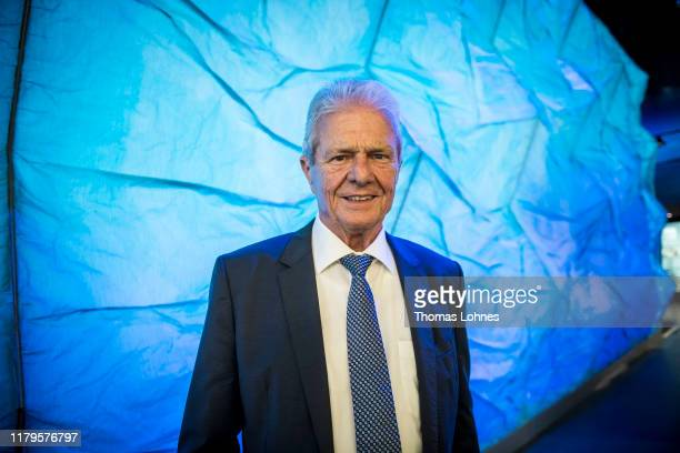 Dietmar Hopp speaks to the media in front of an iceberg model after the opening of the Klima Arena or Climate Arena on October 7 2019 in Sinsheim...