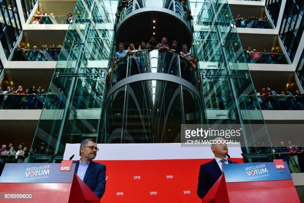 Dietmar Nietan , treasurer of Germany's Social Democrats party, and SPD members look on as Olaf Scholz , interim leader of the SPD, comments on the...