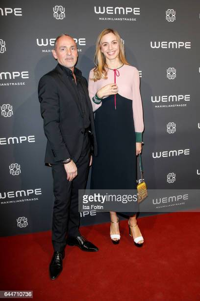 Dietmar Schuelein and german actress Annika Blendl attend the Wempe store opening with the Rolls Royce shuttels in front of the store on February 23...