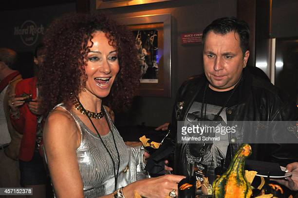 Dietmar Schwingenschrot and Christina Lugner arrive at the Hard Rock Cafe Vienna grand opening party on October 11 2014 in Vienna Austria