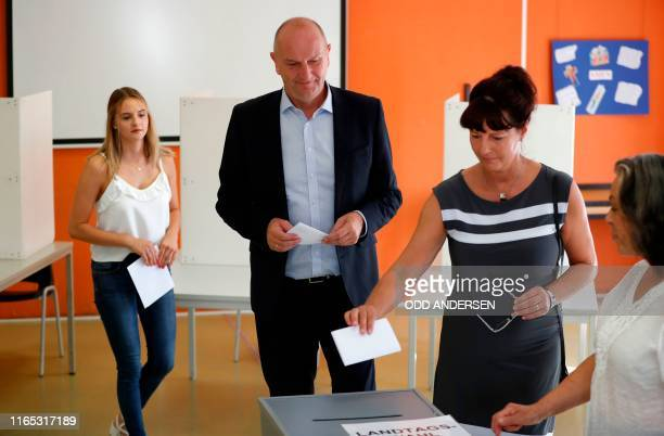Dietmar Woidke Brandenburg's State Premier and top candidate of his social democratic SPD party his wife Susanne and her daughter Luise arrive to...
