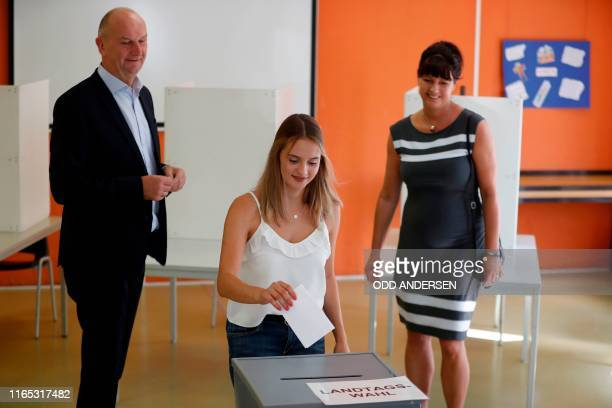 Dietmar Woidke Brandenburg's State Premier and top candidate of his social democratic SPD party and his wife Susanne look on as Susanne's daughter...