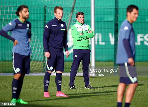 Dietr Hecking, head coach of Wolfsburg looks on during a training sessiosn ahead of the UEFA Champions League group B match between VfL Wolfsburg and...