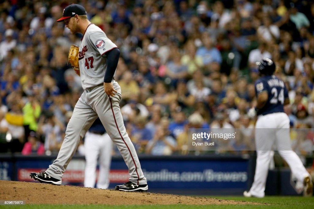 Dietrich Enns #47 of the Minnesota Twins reacts after walking in a run in the third inning against the Milwaukee Brewers at Miller Park on August 10, 2017 in Milwaukee, Wisconsin.
